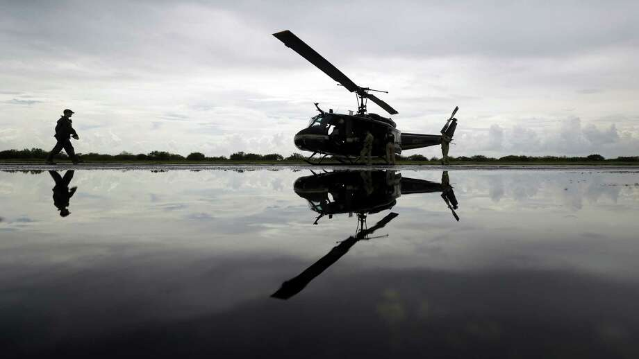 U.S. Customs and Border Protection agents prepare for a patrol flight along the Texas-Mexico border near McAllen. At the peak of the crisis in June, illegal crossings reached a weekly high of 6,600. Photo: Eric Gay / Associated Press / AP