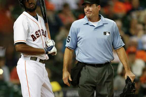 Plate ump Angel Hernandez breaks the bad news to the Astros' Dexter Fowler that he has been called out on strikes in Tuesday night's third inning. It was one of 14 K's in seven innings for Indians starter Corey Kluber.