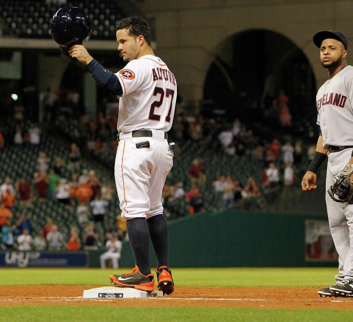 With a tip of his helmet Tuesday night, Jose Altuve acknowledges the Minute Maid Park crowd, and particularly Craig Biggio, during a passing-of-the-torch moment from one Astros second baseman to another. Altuve's seventh-inning single was his 211th hit of the season, one better than the club record set by Biggio in 1998.