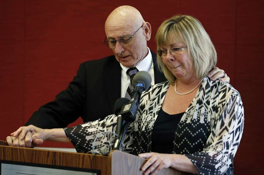 Lonnie and Sandy Phillips, parents of 2012 shooting rampage victim Jessica Ghawi, speak during a news conference Tuesday. Photo: Brennan Linsley / Associated Press / AP
