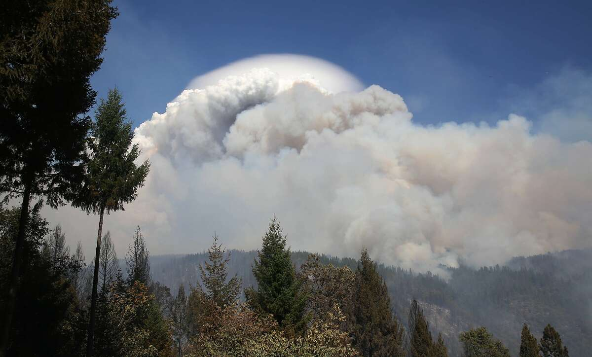 Smoke from a wildfire rises into the sky near Pollack Pines, Calif., Monday, Sept. 15, 2014. The fire, which started Sunday has consumed more than 3,000 acres and forced the evacuation of dozens of homes. (AP Photo/Rich Pedroncelli)