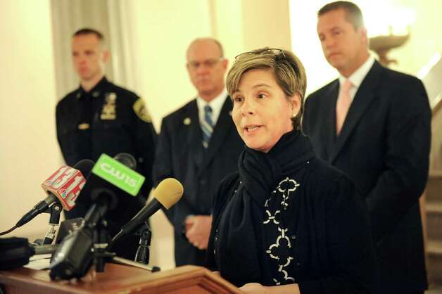 """Sue Riedy, senior public health planner with the Albany County Department of Health, addresses emergency preparedness during a news conference on Tuesday, Sept. 16, 2014, at the Albany County Court House in Albany, N.Y. Joining her are, from left, Deputy Joe Guice, Albany County Clerk Bruce Hidley and Sheriff Craig D. Apple Sr. This year's theme is """"Be Disaster Aware, Take Action to Prepare."""" (Cindy Schultz / Times Union) Photo: Cindy Schultz / 00028626A"""