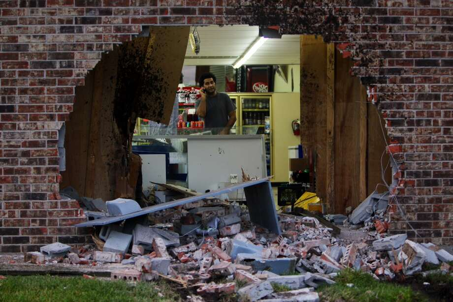 An employee surveys the damage at the Sunny Food Mart located at 9802 Hillcroft Ave. HPD reports nothing stolen.