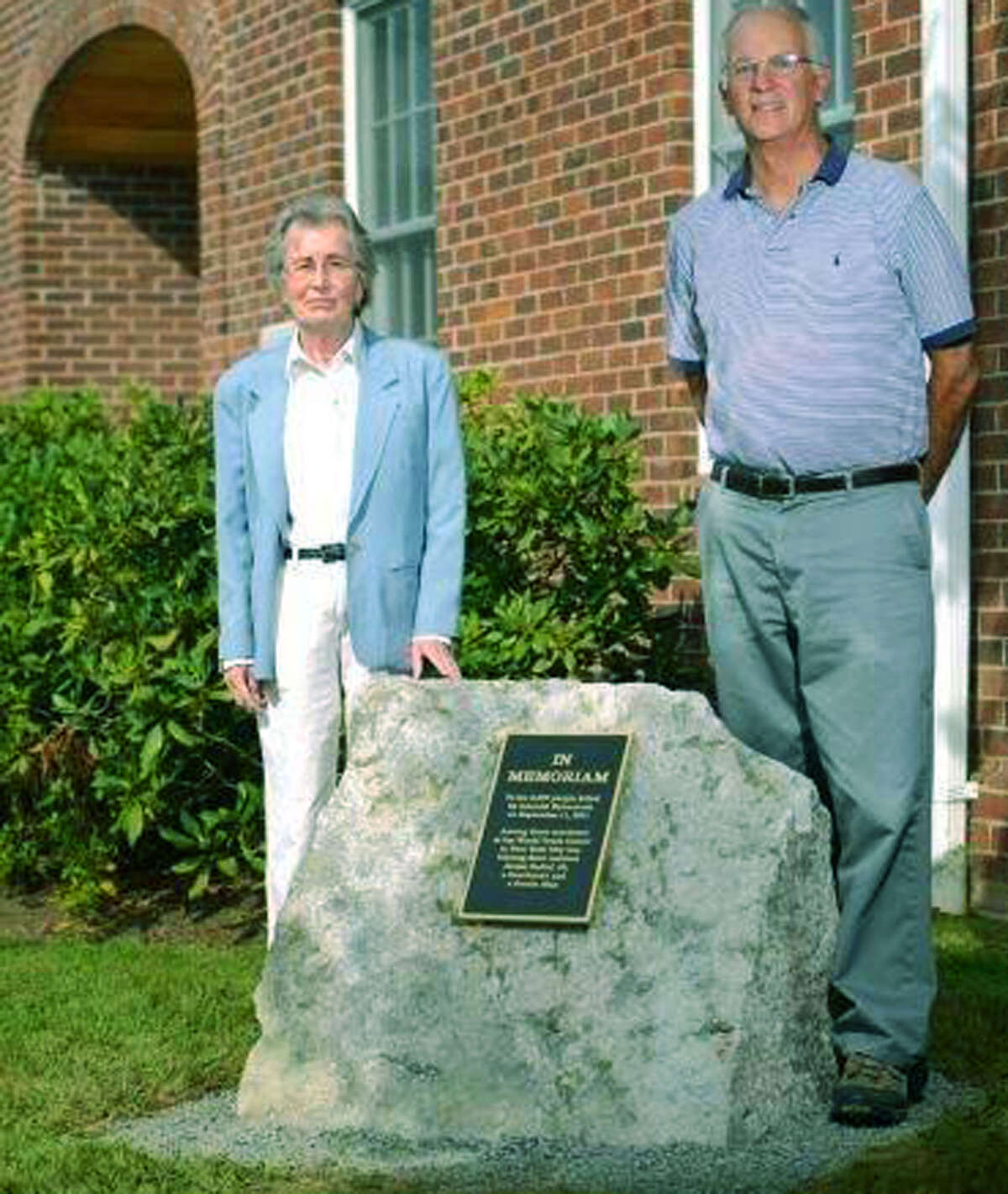 First Selectman Bruce Adams and Selectwoman Susi Williams pose proudly with a newly dedicated 9/11 memorial at Kent Town Hall. September 2014