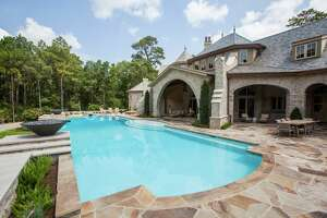 A junior Olympic-sized pool and lots of patio seating makes the outdoor space perfect for large parties.