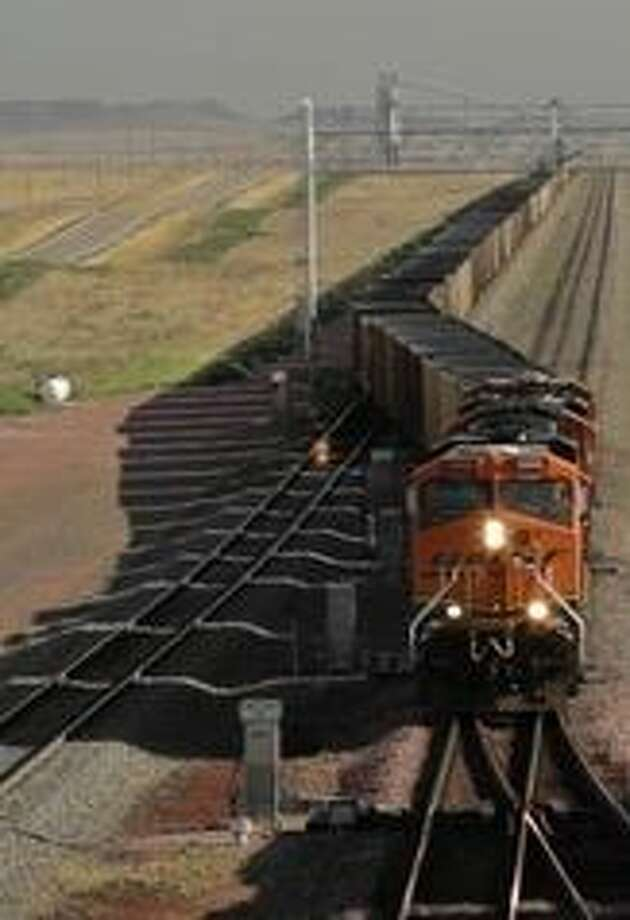 Coal trains can be more than a mile long. The cities of Surrey and New Westminster in British Columbia were not anxious to see them passing through their population centers,. Photo: Dubois