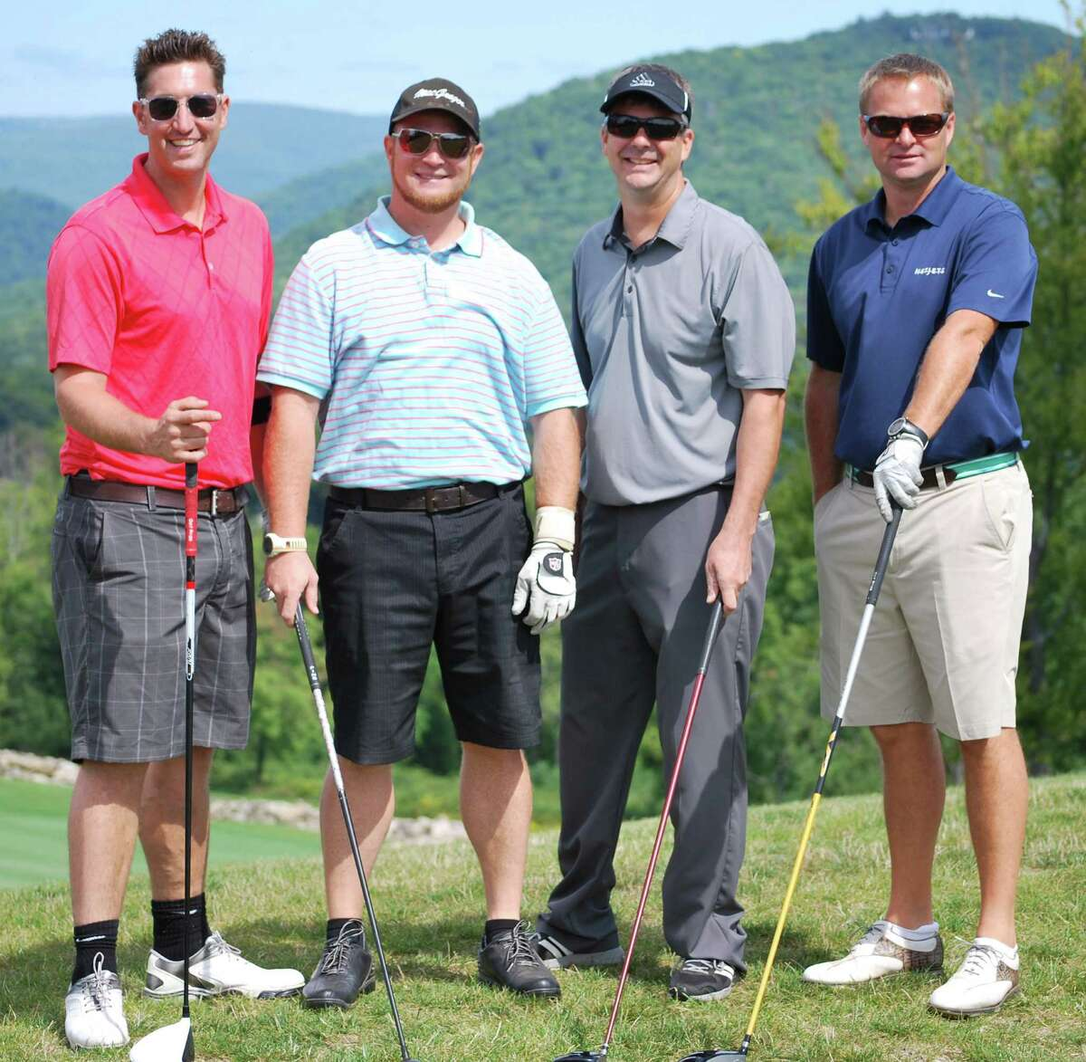The foursome of Keith Fowler, Patrick Brown, Tim Holland and Greg Fenn captured first place in the ninth annual Quad-Am Golf Classic at Bull's Bridge Golf Club in South Kent. Courtesy of YardApes Landscaping