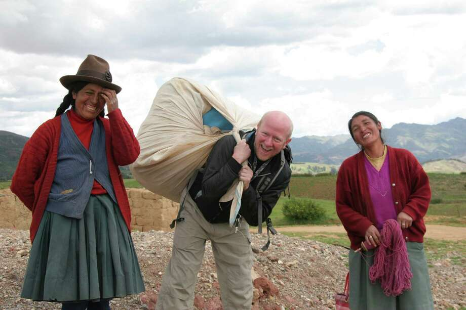 Allan Karl, middle, made it a point to learn about the different countries he visited on his three-year trip. Here, he stands with women from Peru. Photo: Contributed Photo, Contributed / Darien News Contributed