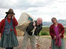 Allan Karl, middle, made it a point to learn about the different countries he visited on his three-year trip. Here, he stands with women from Peru.