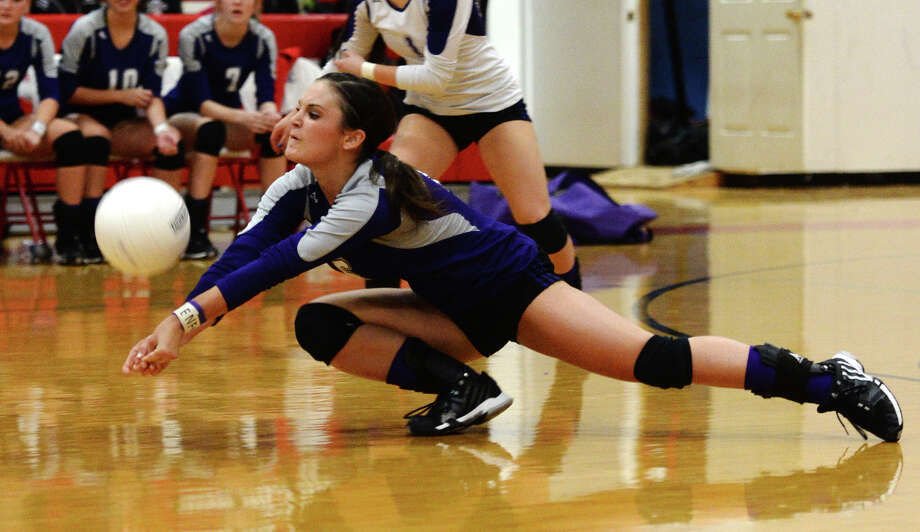 Port Neches-Groves' Emily Taubert, No. 6, lunges for the ball during Tuesday's game against Lumberton. The Lumberton High School volleyball team hosted Port Neches-Groves on Tuesday afternoon.  Photo taken Tuesday 9/16/14  Jake Daniels/@JakeD_in_SETX Photo: Jake Daniels / ©2014 The Beaumont Enterprise/Jake Daniels