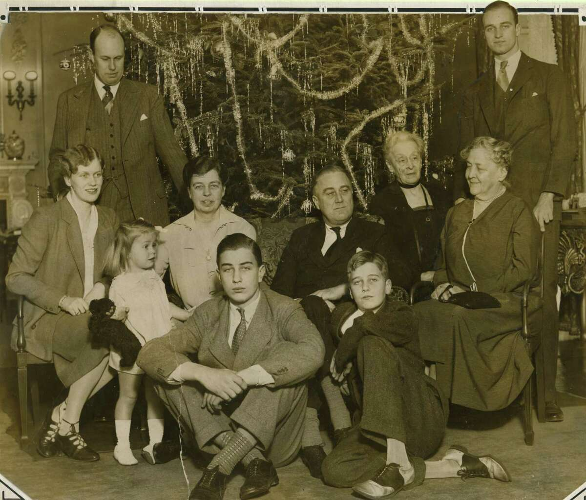 Click through the slideshow for photos from the holiday season in the Capital Region through the years. Roosevelt family Christmas photo dated 1930. Franklin Delano Roosevelt, center, right, wife, Eleanor Roosevelt, center left, and mother, Sara Ann Delano, right. (Times Union archive)