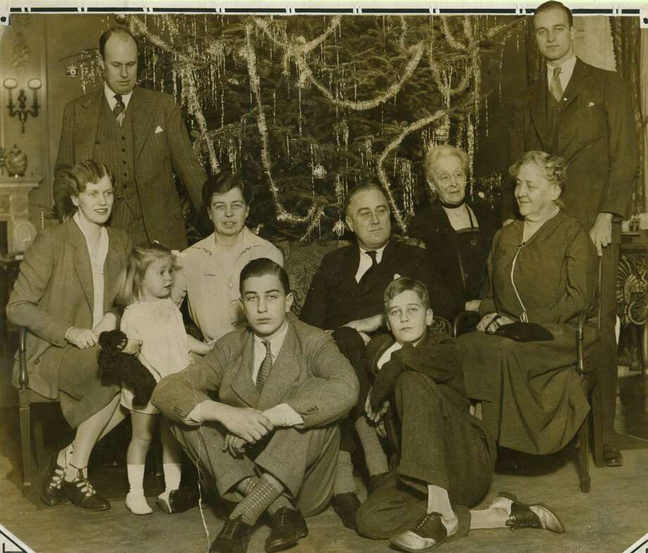 Click through the slideshow for photos from Christmas time in the Capital Region through the years.Roosevelt family Christmas photo dated 1930. Franklin Delano Roosevelt, center, right, wife, Eleanor Roosevelt, center left, and mother, Sara Ann Delano, right. (Times Union archive)