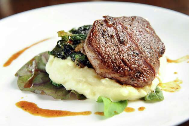 Beef filet with mashed potato and wilted kale on Tuesday, Sept. 16, 2014, at Taste in Albany, N.Y. (Cindy Schultz / Times Union) Photo: Cindy Schultz / 00028637A