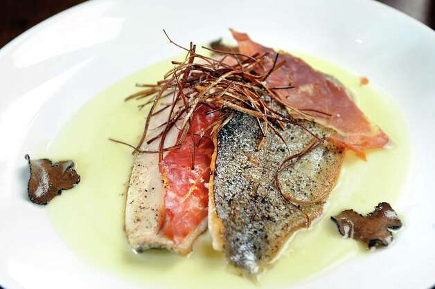 Pan-seared trout with crispy prosciutto, potato leek puree and truffle on Tuesday, Sept. 16, 2014, at Taste in Albany, N.Y. (Cindy Schultz / Times Union) Photo: Cindy Schultz / 00028637A