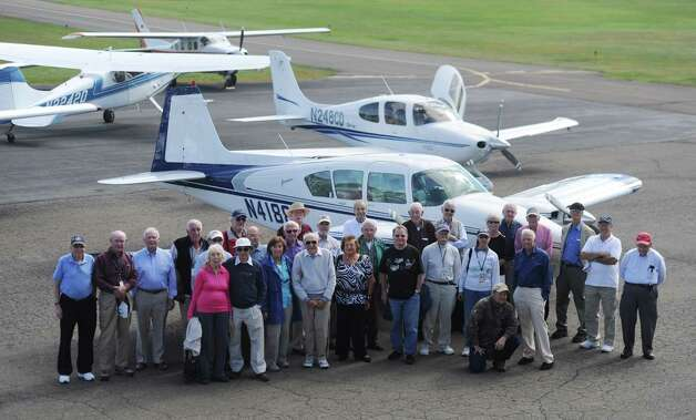 Local members of the the United Flying Octogenarians (UFOs) pose for a photo after a special event at Danbury Airport in Danbury, Conn. Wednesday, Sept. 17, 2014.  The organization is comprised of more than 1,500 pilots age 80 and older spanning across all 50 states and five foreign countries.  The local chapter, organized by Danbury's Bob Barker, occasionally meets at Danbury Airport to catch up and chat with other group members. Photo: Tyler Sizemore / The News-Times