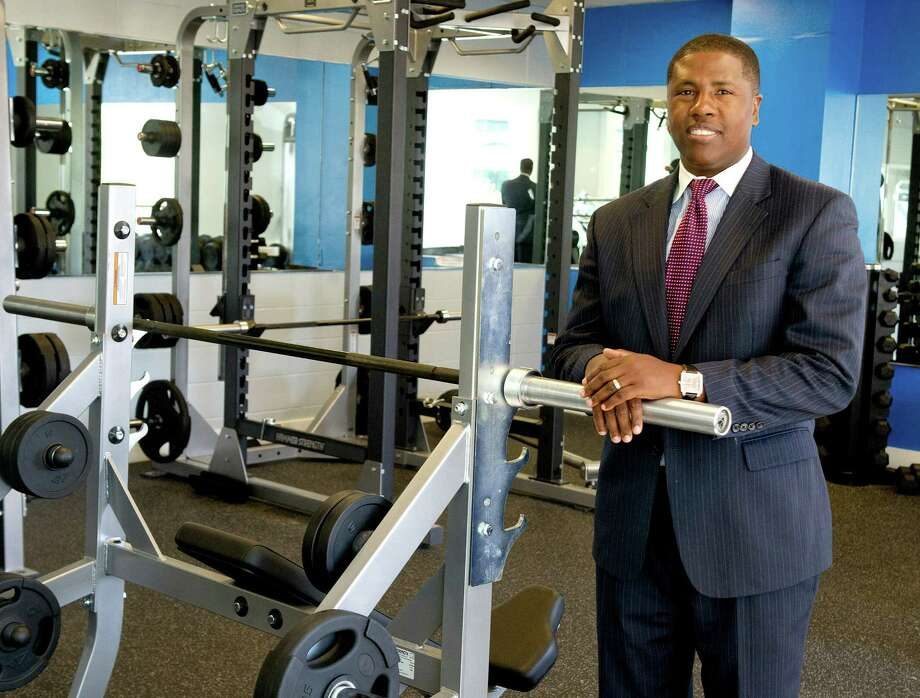 Ernest Lamour, CEO of Stamford YMCA, poses for a photo in the newly renovated weight room on Wednesday, September 17, 2014. Photo: Lindsay Perry / Stamford Advocate