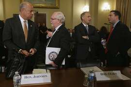 Homeland Security Secretary Jeh Johnson, House Homeland Security Committee member Rep. Ron Barber (D-AZ), National Counterterrorism Center Director Matthew Olsen and committee member Rep. Richard Hudson (R-NC) talk before a hearing on 'worldwide threats to the homeland' in the Cannon House Office Building on Capitol Hill September 17, 2014 in Washington, DC. Although the security and law enforcement officials testified that the Islamic State of Iraq and the Levant, or ISIL, has a sophisticated propaganda and recruitment program, they do not pose a direct threat to the United States homeland.