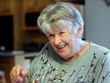 Maxine Mangiafico, 78, of Newtown, Conn., keeps a written running history of the life of each of her six grandchildren.  She talks about it to a reporter, Tuesday, Sept. 16, 2014.