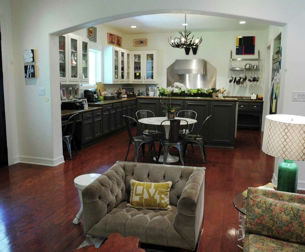 An open floor plan allows for easy communication between those in the living room and those in the kitchen in the home of Tracy and Jack Williams.