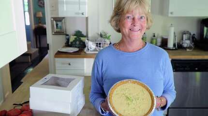 Lulu Morgan holds one of her key lime pies in her Greenwich home, Conn., Wednesday, Sept. 17, 2014. Morgan is the owner and head pie maker for LuLu's Southern Pies, a business that she runs from the kitchen of her home.