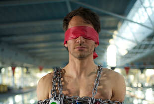 "Todd Sampson attempts a Houdini-style escape on ""Hack My Brain."""