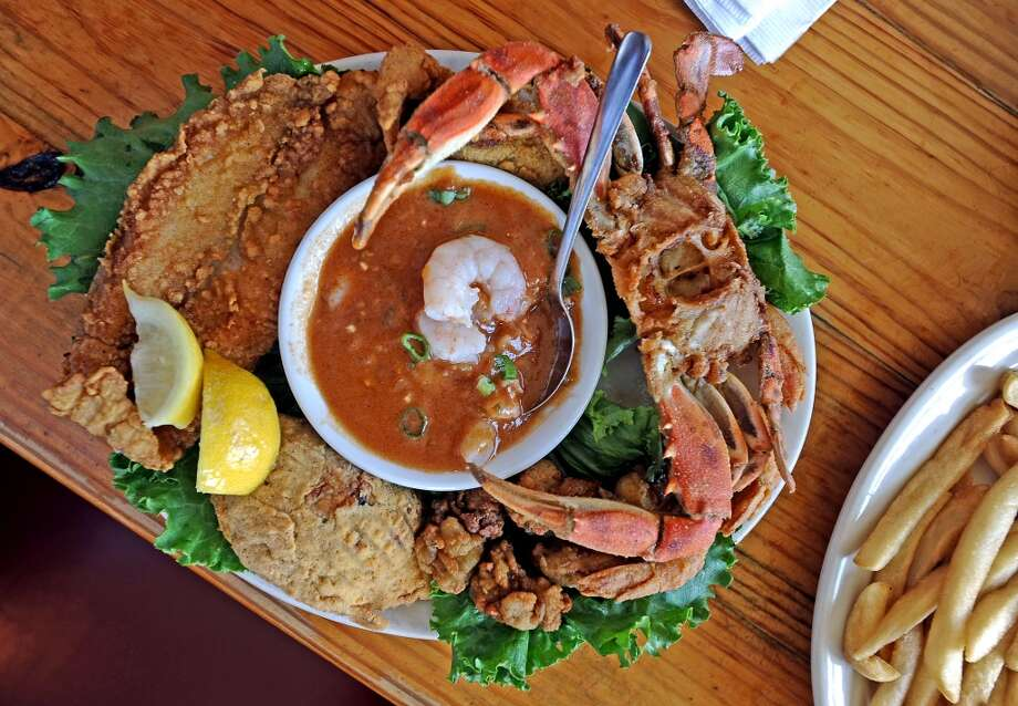 The Stingaree restaurant offers their Fried Seafood Platter on the bay side of Crystal Beach.  Photo taken: Randy Edwards/The Enterprise