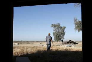 Tribal member Alex Lewis walks through the property owned by his tribe where he hopes a casino will be built Wednesday September 17, 2014. Proposition 48 on the November ballot would approve a state compact allowing the North Fork tribe of Mono Indians to build a large casino on Highway 99 alongside the town of Madera, Calif.