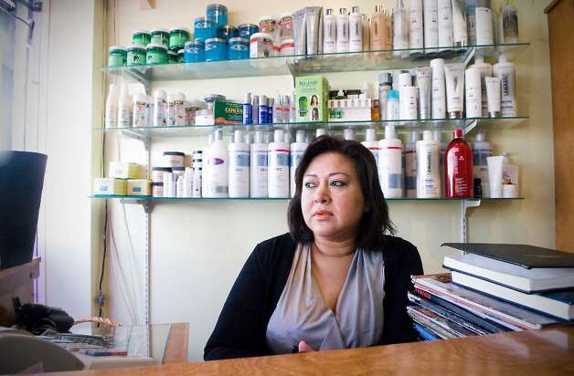 Silvia Torres, owner of Silvia's Beautry Salon, in her East Main Street business.  The building that is home to her business may be taken by the city in an eminent domain case in Stamford, Conn. on Friday, Feb. 19,  2010. Photo: Kathleen O'Rourke / Stamford Advocate
