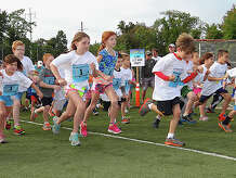 Youngsters leap from the start line as the Half-Mile Kids Run gets underway at the 26th annual Bigelow Tea Community Challenge at the Wakeman Boys & Girls Club in 2013.