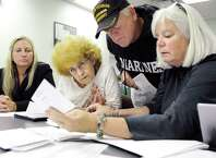 Candidate Howard A. Shafer, center, examines an absentee ballot signature in the 109th Assembly District on Wednesday, Sept. 17, 2014, at Albany County Board of Elections in Albany, N.Y. Joining him, from left, are Jennifer Corona, Carol June-Washington and Pam Robbins. Shafer is running for committee person in Bethlehem District 28. (Cindy Schultz / Times Union)