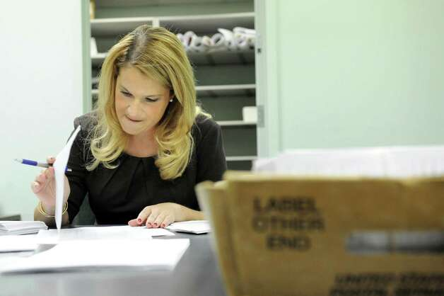 Republican commissioner Rachel Bledi examines ballots in the 110th Assembly District on Wednesday, Sept. 17, 2014, at Albany County Board of Elections in Albany, N.Y. (Cindy Schultz / Times Union) Photo: Cindy Schultz / 00028663A