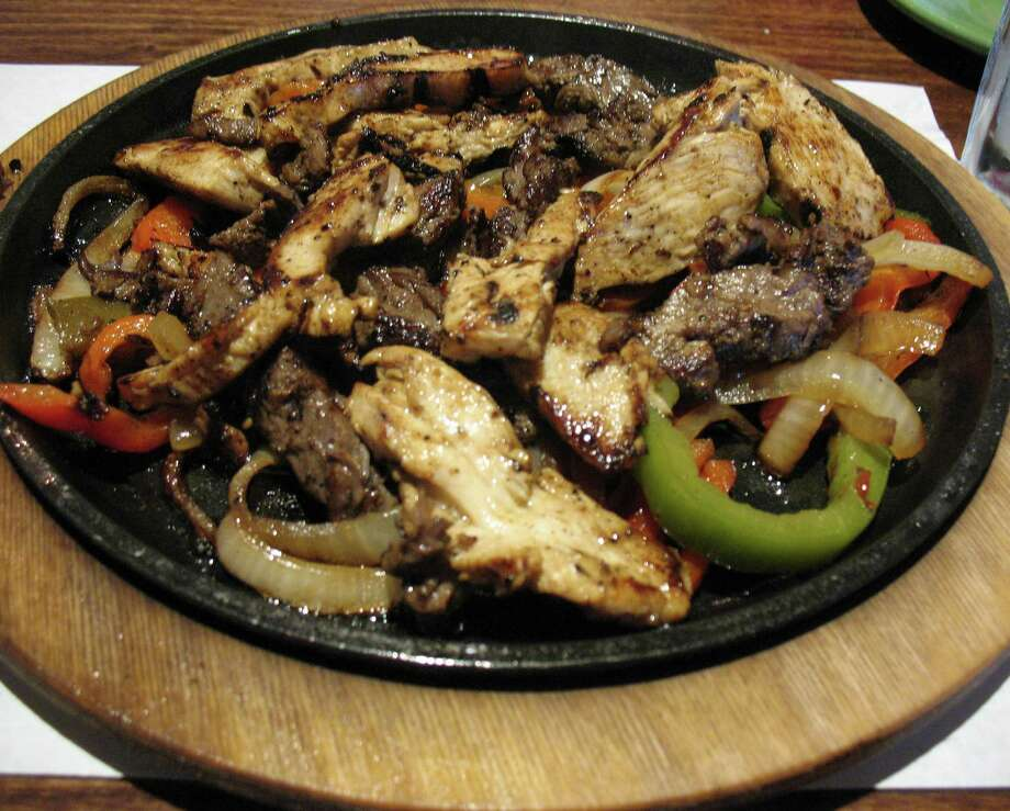 Beef and chicken fajitas are just some of the menu items at La Fonda Alamo Heights. Photo: Edmund Tijerina / San Antonio Express-News