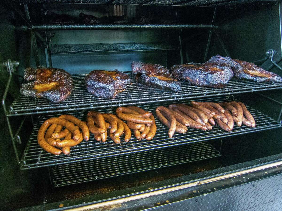 Smoked meats are ready to come out of the smoker at CorkScrew BBQ in Spring.