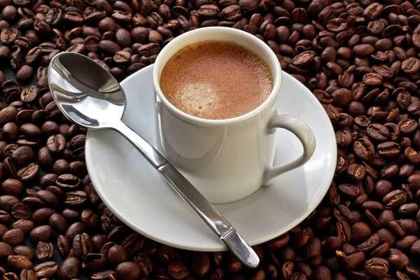 Espresso coffee on coffee beans