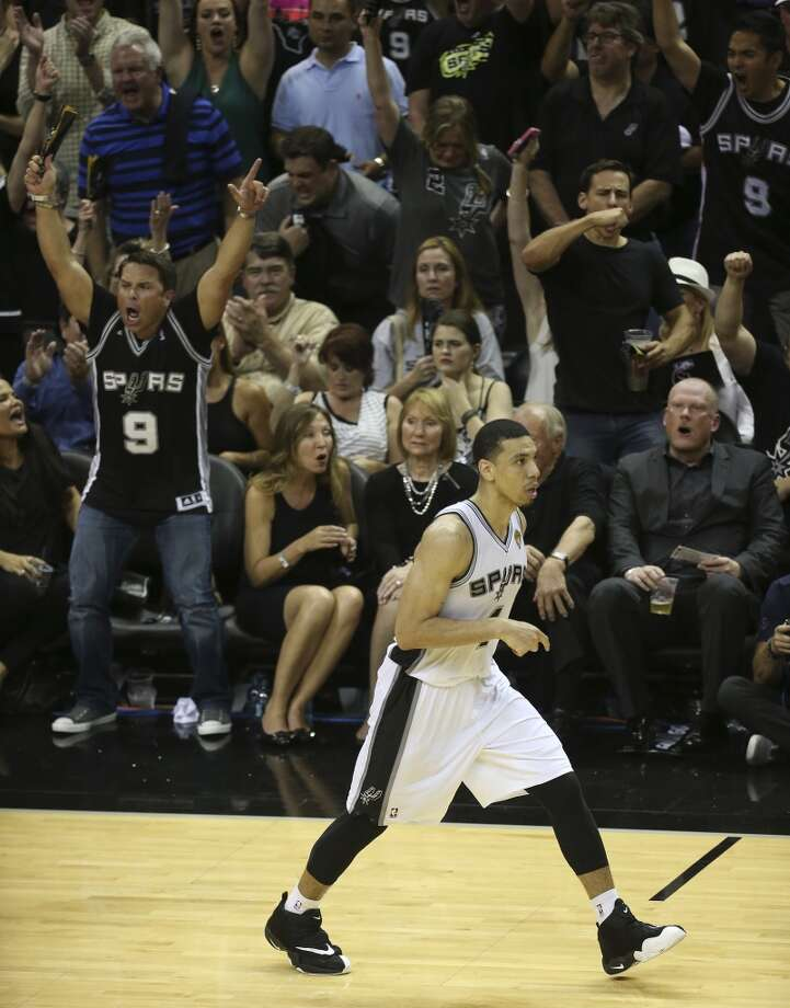 Fans celebrate as San Antonio Spurs' Danny Green hits a three-pointer during the fourth quarter of game one of the NBA Finals against the Miami Heat  at the AT&T Center, Thursday, June 5, 2014. The Spurs won 110-95 to lead the series 1-0. Photo: Jerry Lara, San Antonio Express-News