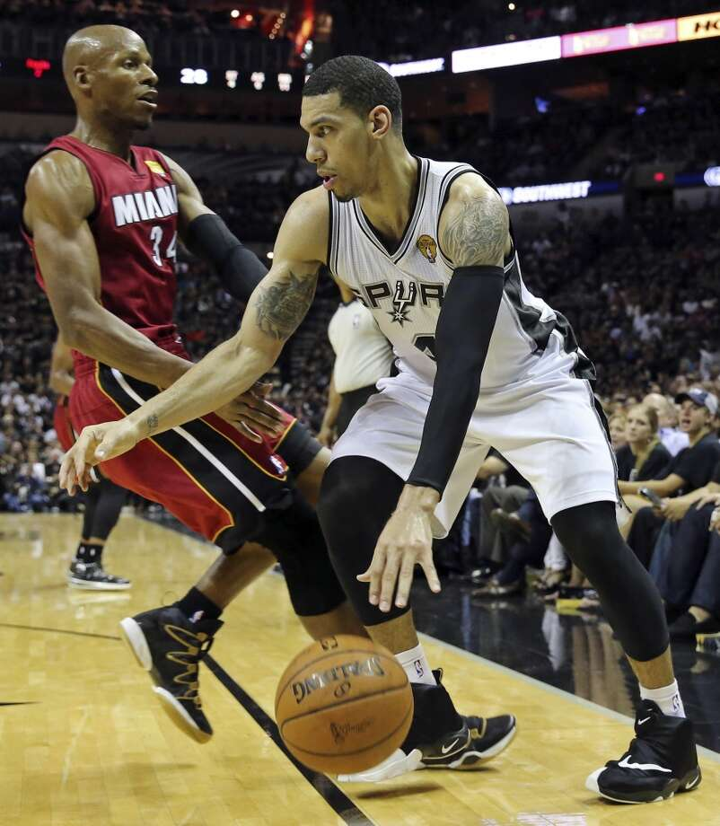 San Antonio Spurs' Danny Green looks for room around Miami Heat's Ray Allen during first half action in Game 1 of the NBA Finals Thursday June 5, 2014 at the AT&T Center. Photo: Edward A. Ornelas, San Antonio Express-News