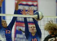 Danbury's Philecia Seipio, 13, and Shannon Geary, 10, go up for the block against Stamford's Anne Eilertsen during the Stamford High School and Danbury High School girls volleyball match, played at Danbury High School, Danbury, Conn, on Wednesday, September 17, 2014. Stamford won the match 3 games to 1.