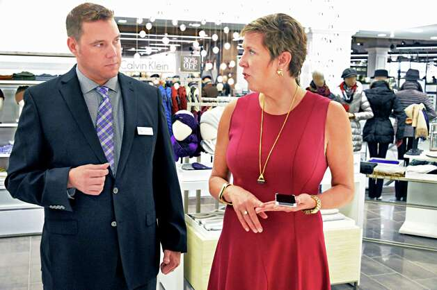 General manager Gregory Towe, left, and executive VP of stores Eileen Dileo ready for the opening at their new Lord & Taylor store in Crossgates Mall Wednesday Sept. 17, 2014, in Guilderland, NY. (John Carl D'Annibale / Times Union) Photo: John Carl D'Annibale / 00028490A