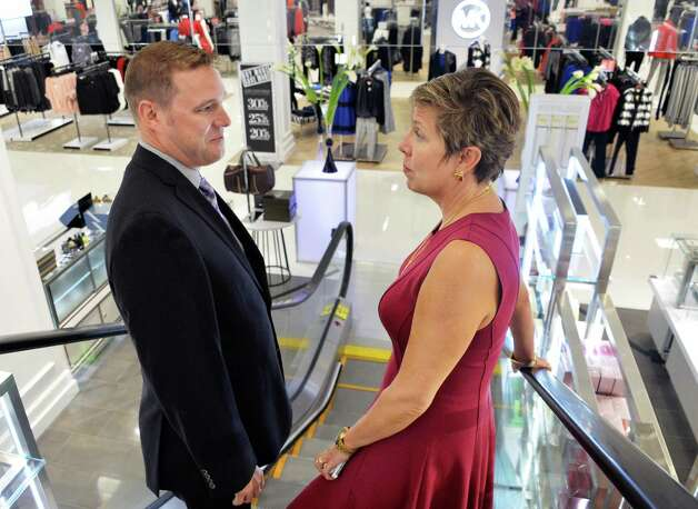 General manager Gregory Towe, left, and executive VP of stores Eileen Dileo confer as they ride down the escalator at their new Lord & Taylor store in Crossgates Mall Wednesday Sept. 17, 2014, in Guilderland, NY. (John Carl D'Annibale / Times Union) Photo: John Carl D'Annibale / 00028490A