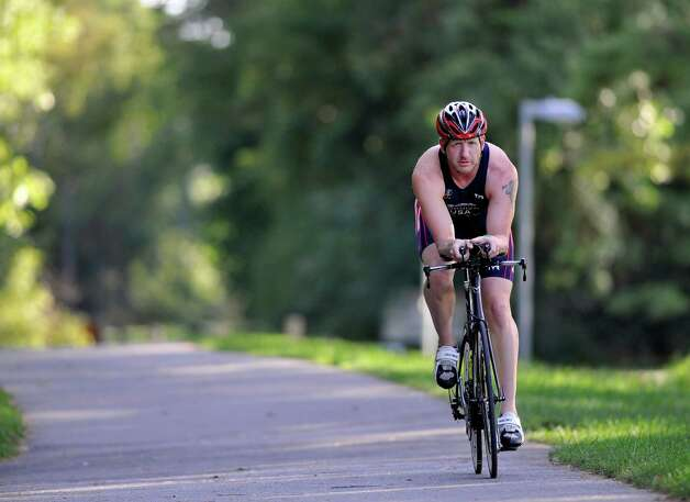 Triathlete Jeff Cornick rides his bicycle on Tuesday, Sept. 10, 2014, in Saratoga Springs, N.Y.  Cornick will be competing in the World Games.  (Paul Buckowski / Times Union) Photo: Paul Buckowski / 00028519A