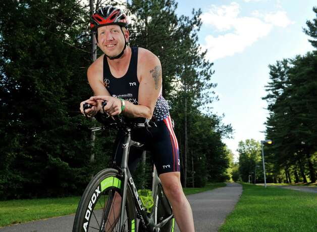 Triathlete Jeff Cornick poses for a photograph on Tuesday, Sept. 10, 2014, in Saratoga Springs, N.Y.  Cornick will be competing in the World Games.  (Paul Buckowski / Times Union) Photo: Paul Buckowski / 00028519A