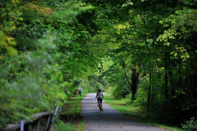 A bicyclist makes her way along the bike path near Lock 7 on Wednesday, Sept. 17, 2014, in Niskayuna, N.Y.   (Paul Buckowski / Times Union) Photo: Paul Buckowski