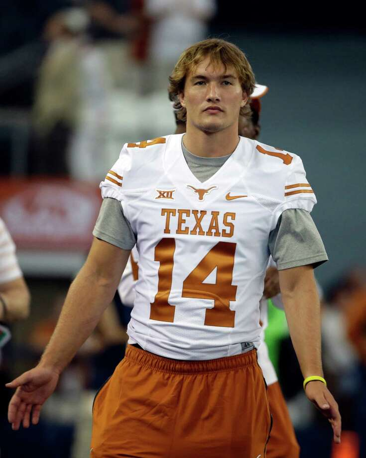Texas quarterback David Ash stands on the sidelines as the team warms up before an NCAA college football game against UCLA, Saturday, Sept. 13, 2014, in Arlington, Texas. (AP Photo/Tony Gutierrez) Photo: Tony Gutierrez, Associated Press / AP