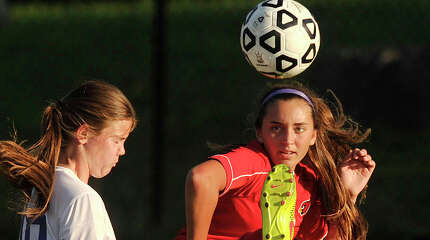 Westhill's Jessica Laszlo and Greenwich's Katherine Doyle compete for the ball in the air during their game at Westhill High School in Stamford, Conn., on Wednesday, Sept. 17, 2014. Westhill won, 2-1.
