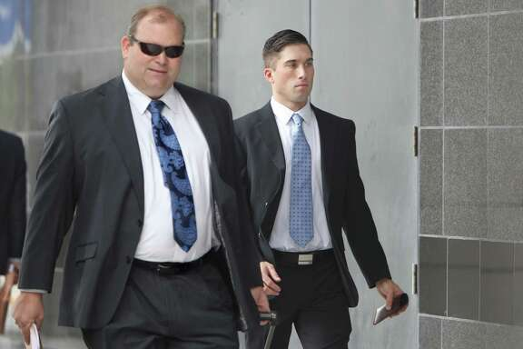 Richard King, right, West Point cadet, who was beaten by a Patti LaBelle bodyguard, enters the US Federal Courthouse for jury selection Tuesday, Sept. 16, 2014, in Houston, Texas. Legendary R&B diva Patti LaBelle is in court over a multimillion-dollar lawsuit against herself and others over a fight between her bodyguards and King. ( Gary Coronado / Houston Chronicle )