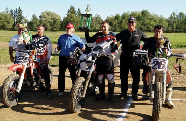 Short track motorcyclists hit the Electric City Raceway at the Indian Lookout Country Club in Mariaville on Sept. 7, which included a tight race between Jake Constantine of Selkirk and Lowell Carson of Delanson for the 22nd annual Memorial Cup Event. Constantine held on to win. From left, Eric Kvinlaug District 3 Sports Committee representative; Jay Maloney; starter Kevin Clark; Jake Constantine; starter Brian Bradshaw and Lowell Carson. Championships will be decided on Sept. 28.