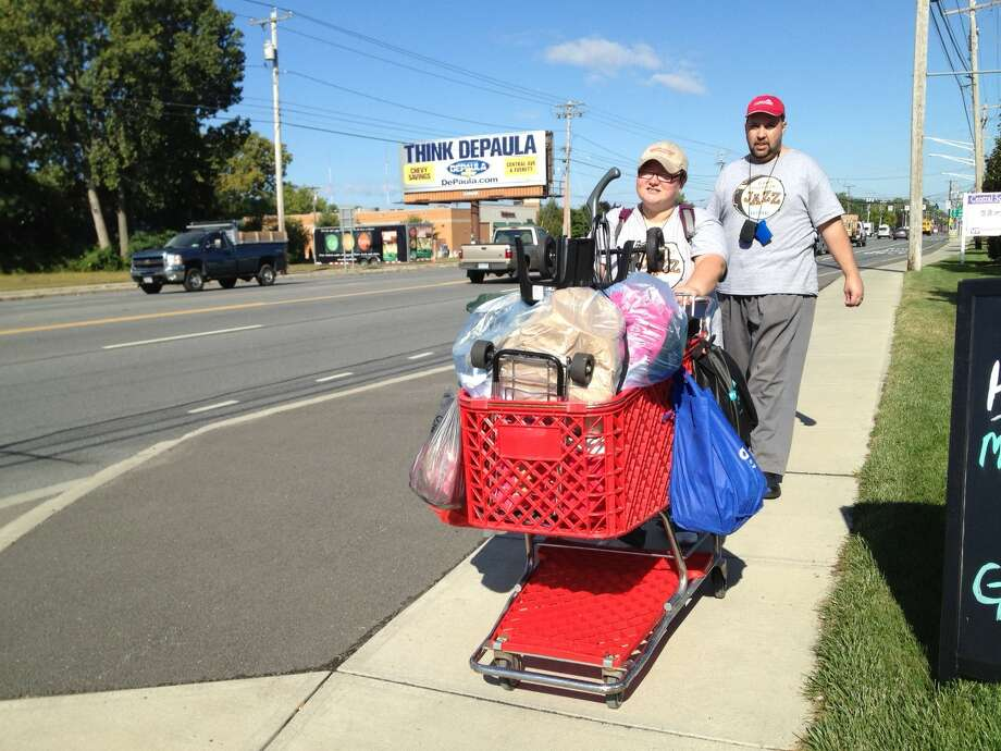 Kristie and James Lynch trudge along Central Avenue on Wed., Sept. 17 with all their belongings in tow after they were evicted from the Best Value Inn on Central Avneue in a dispute with the Schnectady County Department of Social Services, who stopped payment on the hotel room where they had been staying for the past two months. The homeless couple has nowhere to go. (Paul Grondahl / Times Union)