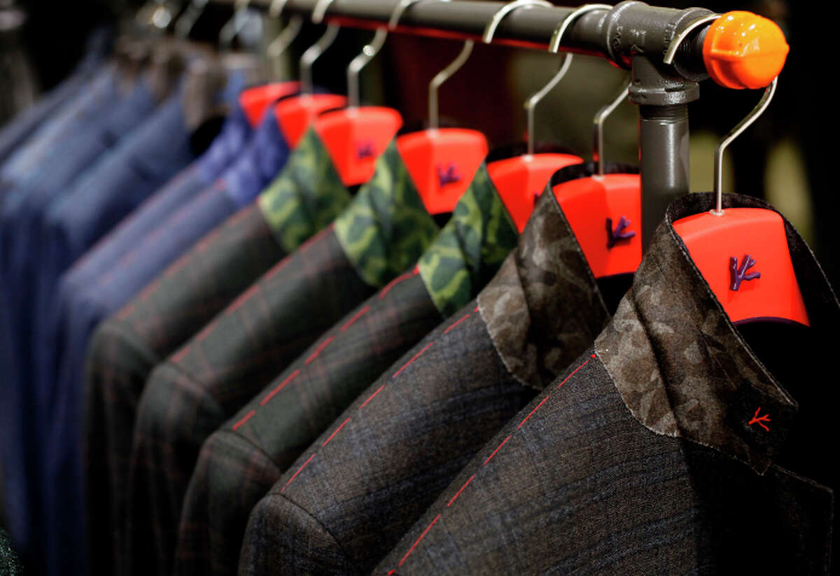 Sam Malouf in Burlingame is known for luxury wear like these Isaia suits with camouflage under-collars.