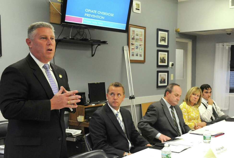Assemblymember John T. McDonald III, left, speaks during a Heroin/Opiate Community Education Forum he sponsored on Wednesday Sept. 17, 2014 in Watervliet, N.Y. (Michael P. Farrell/Times Union)
