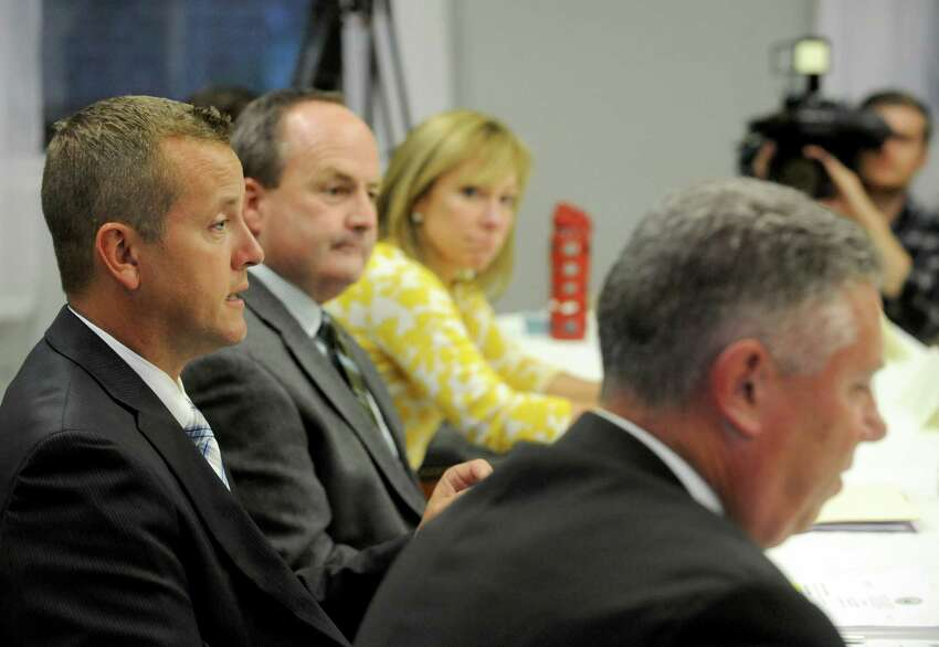 Albany County Sheriff Craig D. Apple, left, speaks during a Heroin/Opiate Community Education Forum sponsored by Assemblymember John T. McDonald III on Wednesday Sept. 17, 2014 in Watervliet, N.Y. (Michael P. Farrell/Times Union)